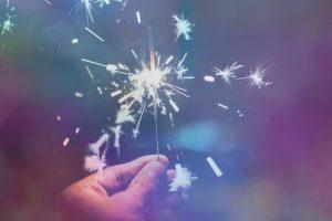A sparkler in a persons hand
